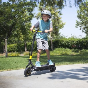 A boy rides the Sonic XL electric scooter